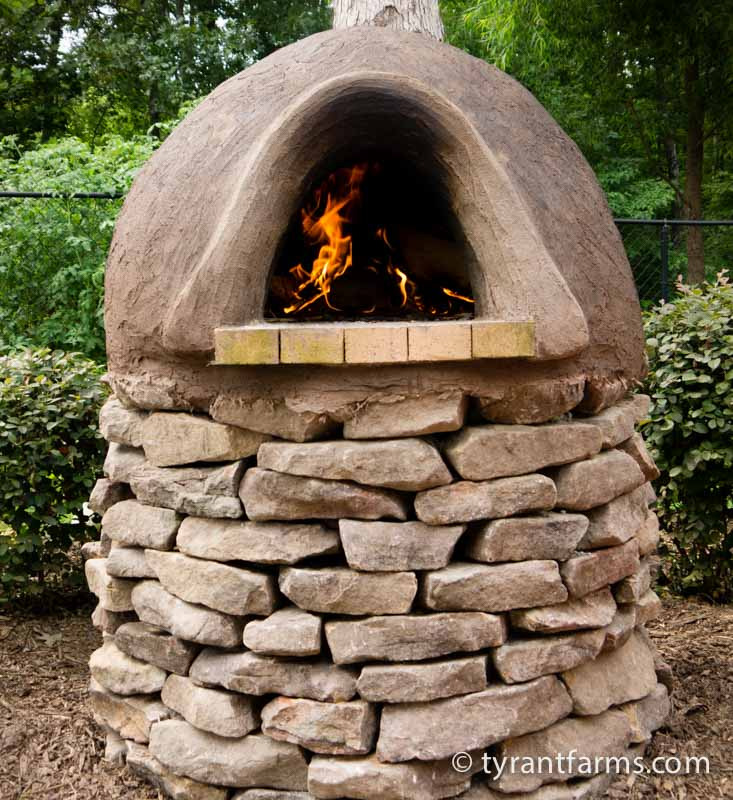This is our cob oven, but we encourage you to carefully think through the both the functional and aesthetic design (and location) of your cob oven before getting started.