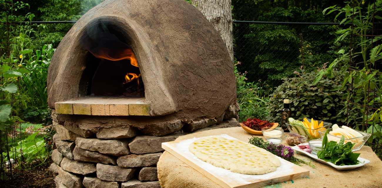 Our wood-fired cob oven. Click the image to see a detailed materials list and how-to-build guide.