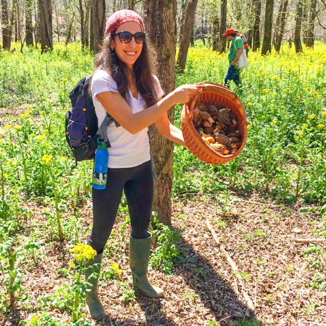 Happy Tyrant with her basket starting to fill with morel mushrooms!