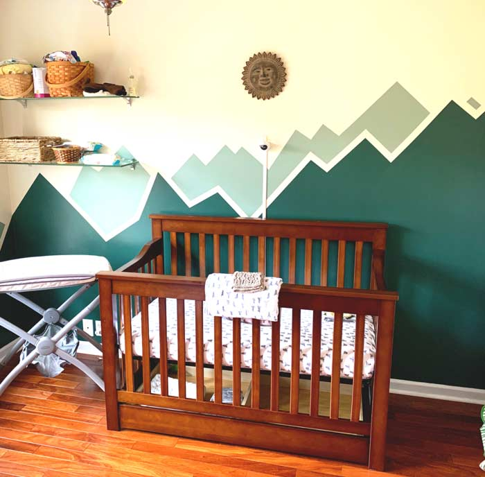 Baby nursery painted with mountains.