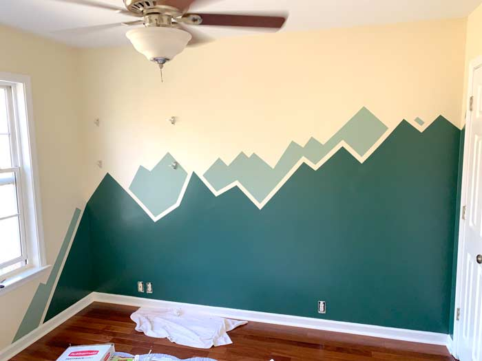 Paint tape all removed. Baby nursery mountain painting.