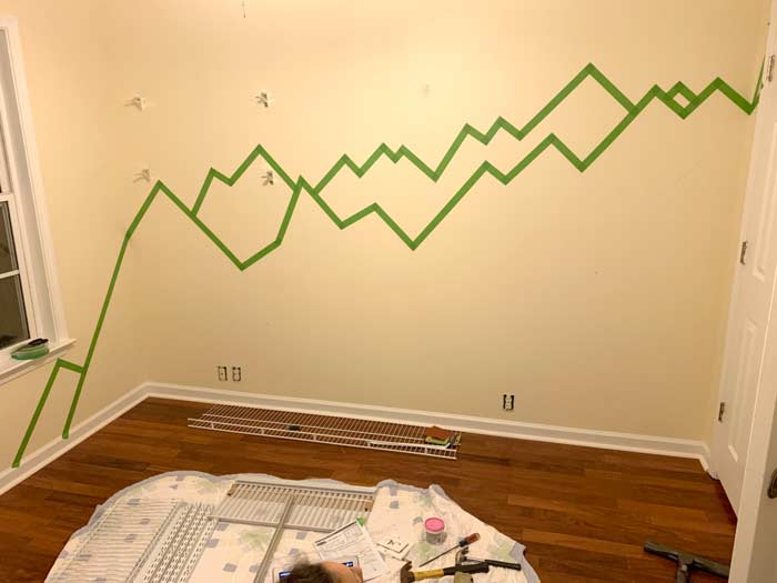 Paint tape outlining the mountains in the baby nursery.