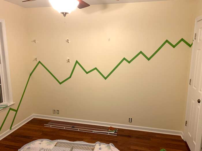 Baby nursery paint prep: First layer of paint tape outlining the foreground mountains.