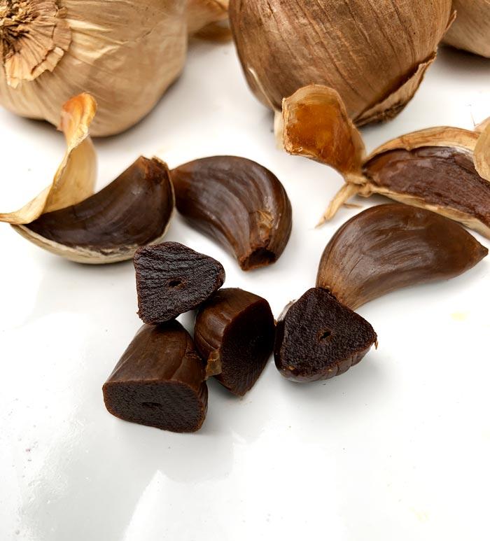 Homegrown hardneck garlic transformed into delicious black garlic in a dehydrator.