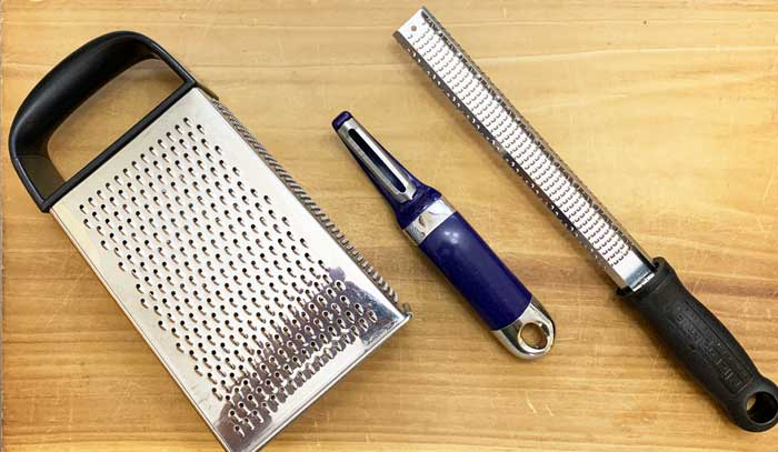Common kitchen tools that can be used for removing and saving the skin of oranges. Kitchen grater, carrot peeler, and microplane. A microplane is by the best tool for making citrus zest, in our opinion.