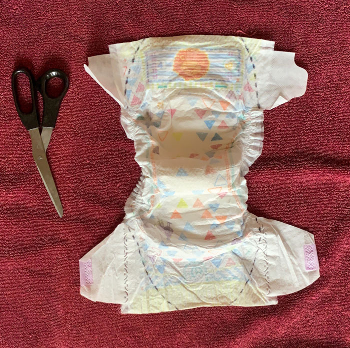 2. Prepare for cutting! Dotted lines are placed on the diaper insert to show you where the first cuts to trim and remove the diaper flaps will be made.