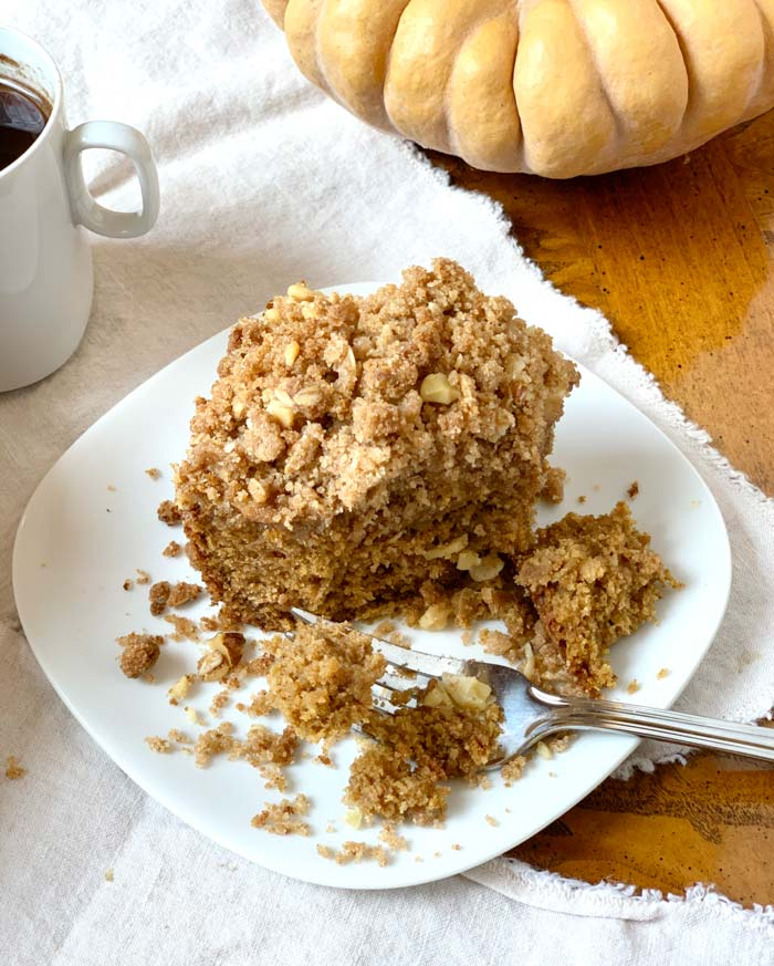 Mmm, fall harvest coffee cake with pumpkins, apples, and walnuts - delicious to the last piece of crumbly goodness.