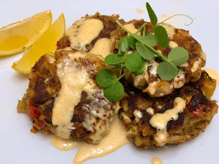 Oh, yes. Forest and garden to table goodness. Lion's mane mushroom crabcakes topped with homemade garlic aioli, Austrian winter pea greens, and slices of fresh Meyer lemons.
