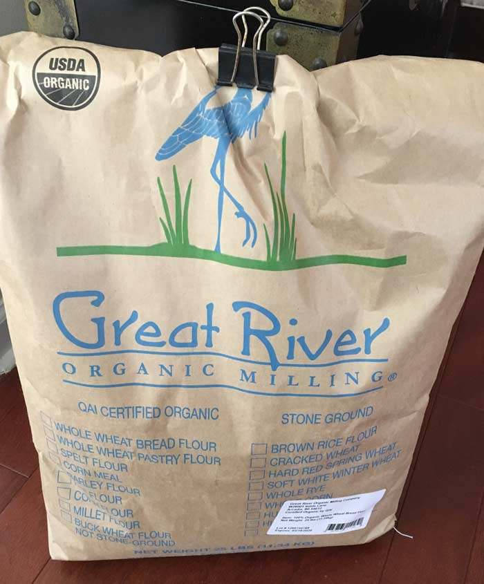 Our 25 lb bag of Great River certified organic stone ground whole wheat flour.