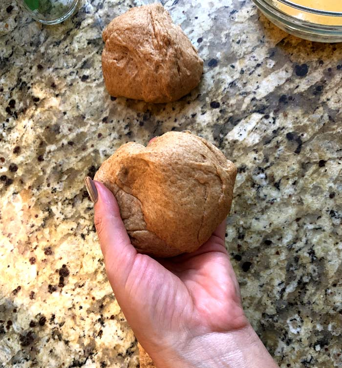 The dough for each poğaça should be a little bigger than a baseball. You'll want to separate the dough into individual balls before proceeding.