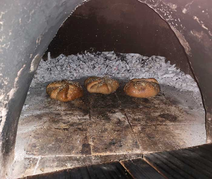 A single row made it much easier to get to and turn each poğaça. Cob oven baking.