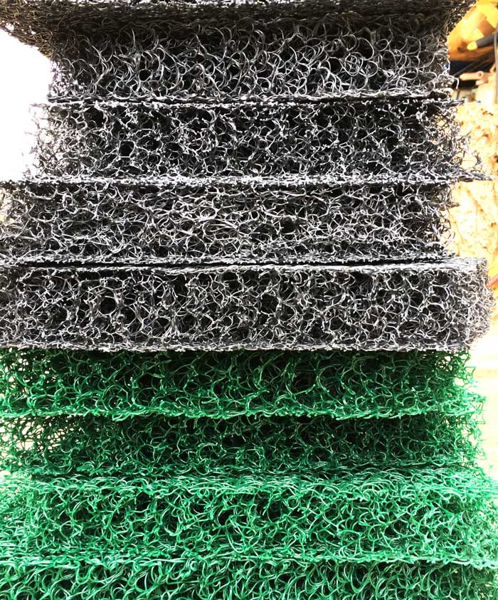 Grey and green Matala filter pad pieces.
