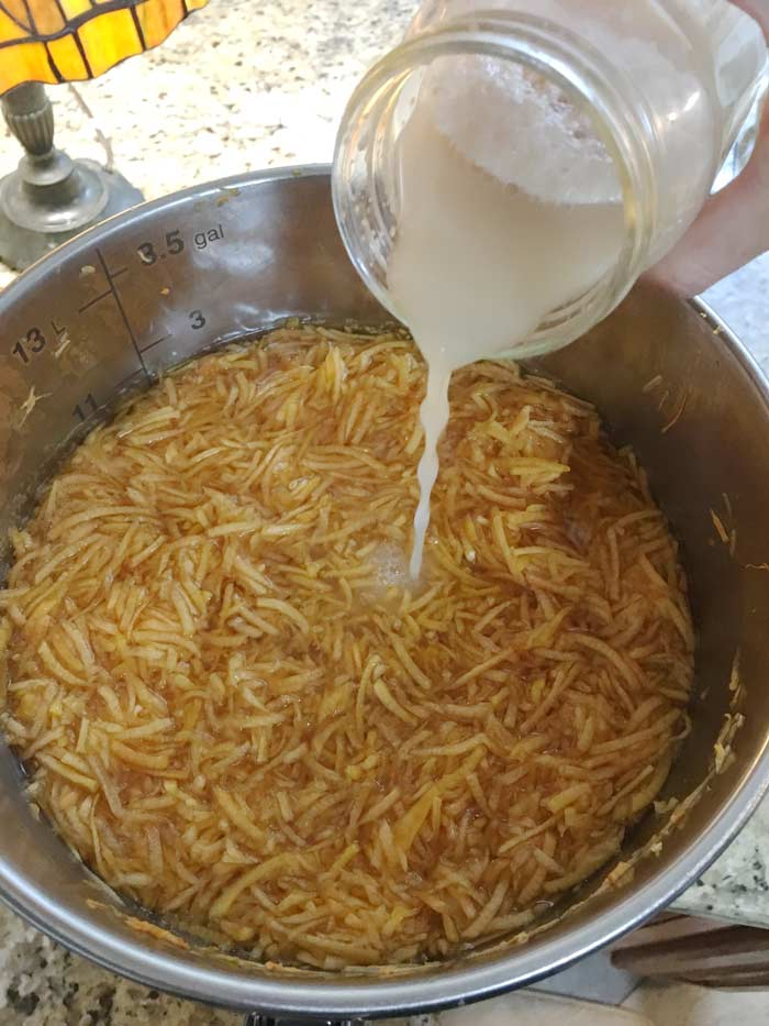 24 hours after the Campden tablet has been added and had a chance to wear off, you'll be adding your champagne yeast. Also notice how much color has already leached out of the grated pumpkin into the water.