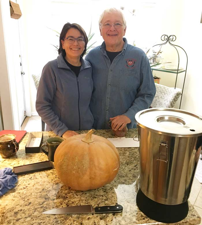 Andrea Deyrup and Tony Williamson in front of a Williamson pumpkin that's about to be made into champagne.