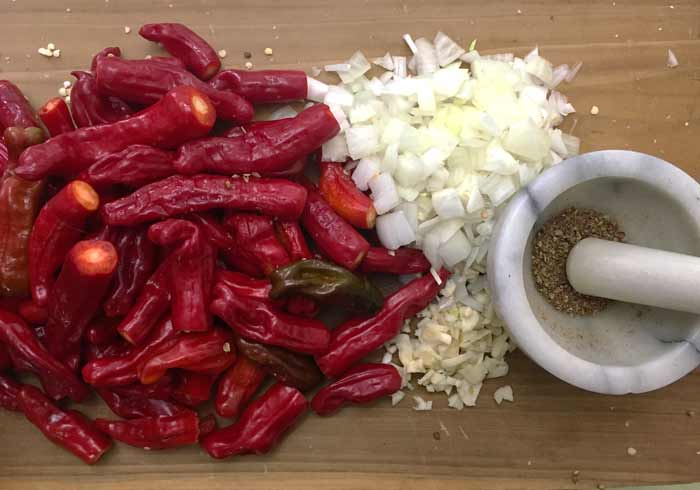 Preparing the ingredients for red Shishito pepper soup: fresh ground coriander seeds (right) add a big flavor boost.