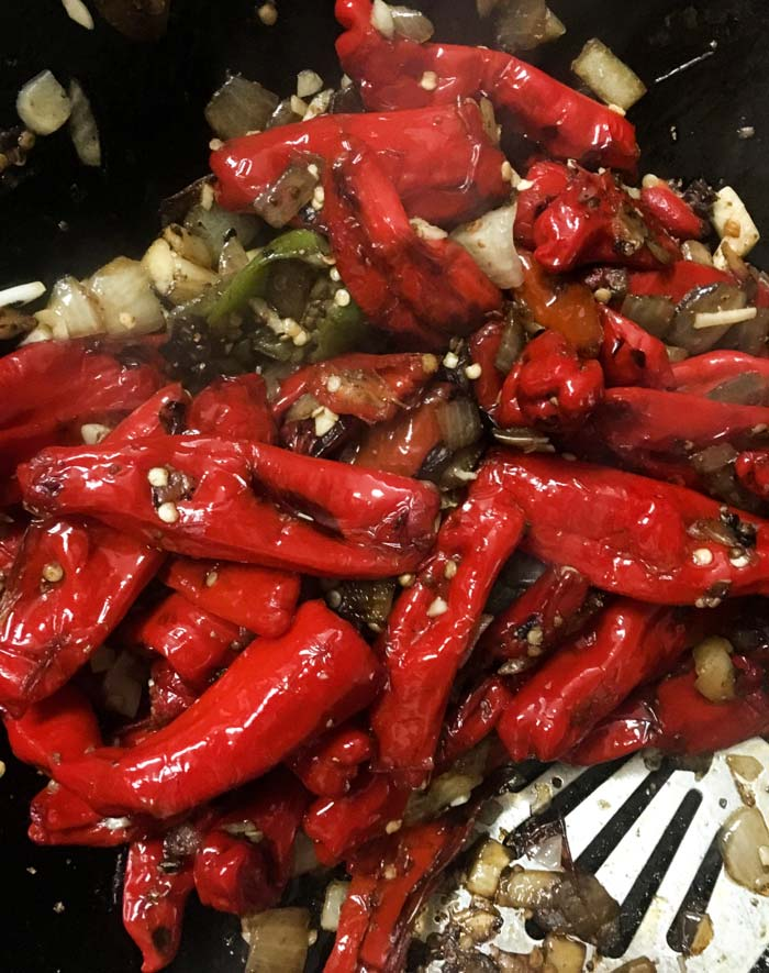 Once peppers are soft and are starting to blister (3-5 minutes), add the onions & sauté together for 5 minutes.