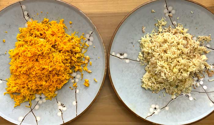 Freshly grated orange and white turmeric ready to be made into turmeric bugs.