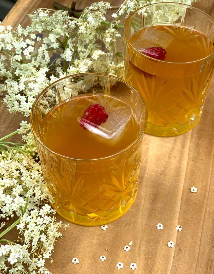 Elderberry kombucha with raspberry ice cubes.