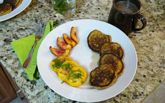 We ate this batch of summer squash pancakes with fresh organic peaches & vine-ripened tomatoes sprinkled with globe basil. The Tyrant was quite pleased with the offering.