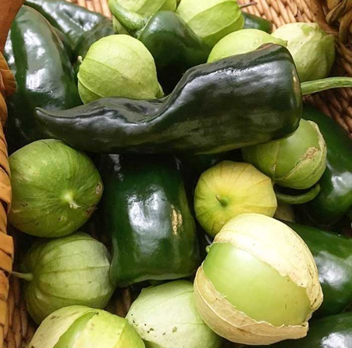 Tomatillos and poblano peppers: the makings for a mighty good meal. Stuffed peppers with salsa verde is hard to beat.